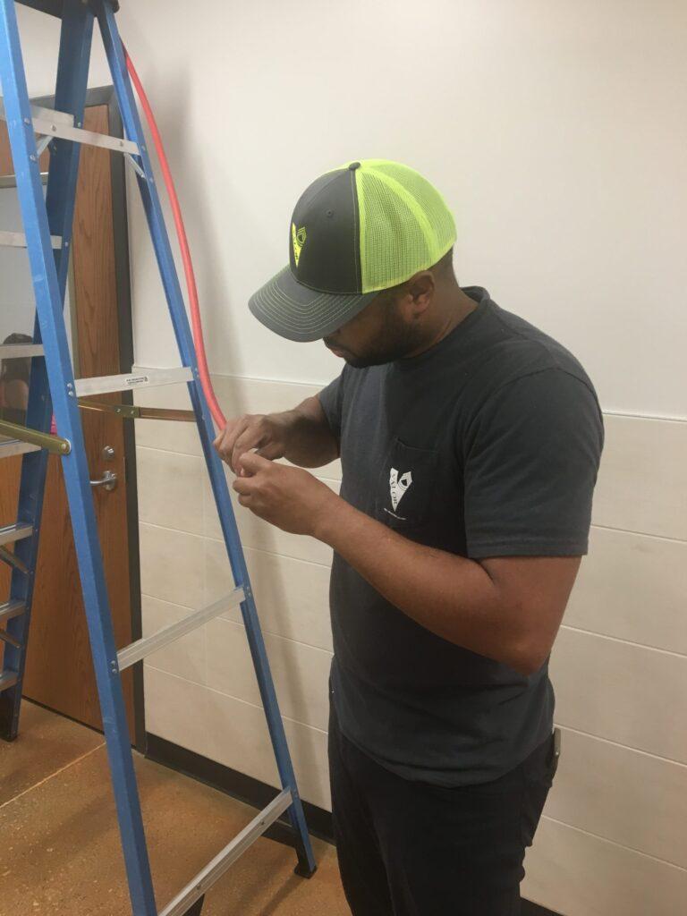 Valor Staff Installing Cabling